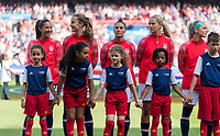 PARIS,  - JUNE 16: Christen Press #23, Tierna Davidson #12, Ali Krieger #11, and Lindsey Horan #9 stand for the national anthem during a game between Chile and USWNT at Parc des Princes on June 16, 2019 in Paris, France.
