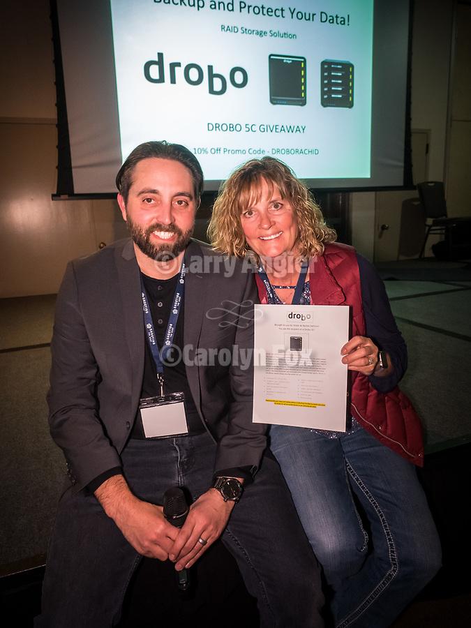 Rachid Danhouan presents to Linda Hammond a Dobro unit at the The Friday symposium at STW XXXI, Winnemucca, Nevada, April 12, 2019.<br /> .<br /> .<br /> .<br /> .<br /> @shootingthewest, @winnemuccanevada, #ShootingTheWest, @winnemuccaconventioncenter, #WinnemuccaNevada, #STWXXXI, #NevadaPhotographyExperience, #WCVA
