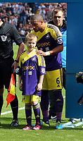Pictured: Ashley Williams and mascot.<br /> Sunday 01 September 2013<br /> Re: Barclay's Premier League, West Bromwich Albion v Swansea City FC at The Hawthorns, Birmingham, UK.