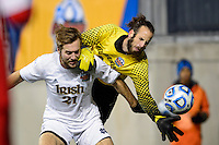 Notre Dame Fighting Irish forward Vince Cicciarelli (21) shields New Mexico Lobos goalkeeper Michael Lisch (0) from the ball. The Notre Dame Fighting Irish defeated the New Mexico Lobos 2-0 during the semifinals of the 2013 NCAA division 1 men's soccer College Cup at PPL Park in Chester, PA, on December 13, 2013.
