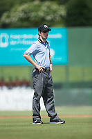 Umpire Tyler Jones handles the calls on the bases during the South Atlantic League game between the Greensboro Grasshoppers and the Kannapolis Intimidators at Intimidators Stadium on July 17, 2016 in Greensboro, North Carolina.  The Intimidators defeated the Grasshoppers 3-2 in game one of a double-header.  (Brian Westerholt/Four Seam Images)