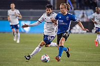 SAN JOSE, CA - MAY 01: Adrien Perez #16 of DC United chases Tommy Thompson #22 of the San Jose Earthquakes during a game between San Jose Earthquakes and D.C. United at PayPal Park on May 01, 2021 in San Jose, California.