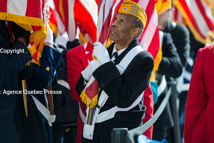 A representatives from the Veterans Service Organization, Marine Corps League Auxiliary, carries a flag through the Memorial Amphitheater on Veterans Day at Arlington National Cemetery, Arlington, Virginia, Nov. 11, 2017.  (U.S. Army photo by Elizabeth Fraser / Arlington National Cemetery / released)