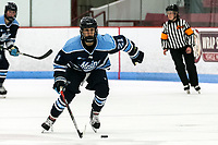 BOSTON, MA - JANUARY 04: Tereza Vanisova #21 of University of Maine brings the puck forward during a game between University of Maine and Boston University at Walter Brown Arena on January 04, 2020 in Boston, Massachusetts.
