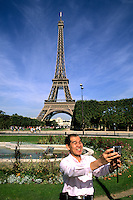 France Famous gardens and Eiffel Tower with Japanese Tourist with camera in Paris France