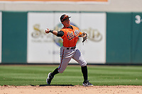 Baltimore Orioles second baseman Andrew Martinez (72) throws to first base during a Minor League Spring Training game against the Detroit Tigers on April 14, 2021 at Joker Marchant Stadium in Lakeland, Florida.  (Mike Janes/Four Seam Images)