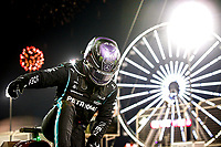 28th March 2021; Sakhir, Bahrain; F1 Grand Prix of Bahrain, Race Day; Lewis Hamilton GBR, Mercedes-AMG Petronas F1 Team  climbs from his car after winning the F1 Grand Prix of Bahrain at Bahrain International Circuit