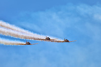 Three Harvard aircraft power across the sky at the Canadian International Air Show in Toronto.