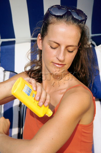 Woman using sun milk