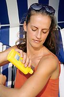 Woman using sun milk