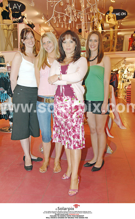 Jacqueline Gold, owner of Ann summers at her store in Valencia with three employees during filming for the brand new LIvingTV show, Break With The Boss..L to r:.Andrea Mann, white top..Eve Tucker, pink top..Jacqueline Gold..Viv Benson, green top..DATE: 13/10/2006-JOB REF: 2920-ITS