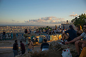 Barcelona, Spain<br /> Catalonia<br /> June 27, 2021<br /> <br /> Muhba, Turó de la Rovira has panoramic views of Barcelona at sunset from Spanish Civil War bunkers where anti-aircraft guns were once installed.