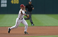 Arkansas infielder Cullen Smith (14) throws, Monday, June 7, 2021 in the first inning of the NCAA Fayetteville Regional at Baum-Walker Stadium in Fayetteville. Check out nwaonline.com/210608Daily/ for today's photo gallery. <br /> (NWA Democrat-Gazette/Charlie Kaijo)