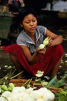 Portrait of a female flower seller at a market, Bagan, Burma.