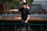 Home plate umpire Darius Ghani throws a new baseball to the pitcher during a California League game between the Lancaster JetHawks and Inland Empire 66ers at San Manuel Stadium on May 20, 2018 in San Bernardino, California. Inland Empire defeated Lancaster 12-2. (Zachary Lucy/Four Seam Images)