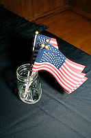 American flags stand in a mason jar before Texas senator and Republican presidential candidate Ted Cruz speaks at a town hall put on by the Concerned Veterans for American at Milford Town Hall in Milford, New Hampshire.