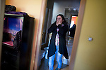 Ecuadorian homeowner Kelly Herrera reacts on March 13, 2012 in her house in Madrid before being evicted. Spain on March 9 approved a new voluntary 'code of conduct' for banks which aims to help poor homeowners settle their debts and reduce a wave of evictions brought on by the economic crisis. Spanish banks currently seize the homes of those who default on their mortgages and often demand further payment from those evicted if the value of the house has fallen below that of the loan. The new rules will apply in cases where every member of a household is unemployed and mortgage payments are equal to more than 60 percent of their income. (c) Pedro ARMESTRE