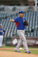 Kyuji Fujikawa of the Chicago Cubs pitches in a rehab assignment for the AZL Cubs during a game against the AZL Rangers at Surprise Stadium on July 6, 2014 in Surprise, Arizona. AZL Rangers defeated the AZL Cubs, 7-5. (Larry Goren/Four Seam Images)