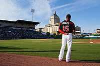 Rochester Red Wings outfielder Victor Robles (15) stands for the national anthem before a game against the Worcester Red Sox on September 4, 2021 at Frontier Field in Rochester, New York.  (Mike Janes/Four Seam Images)