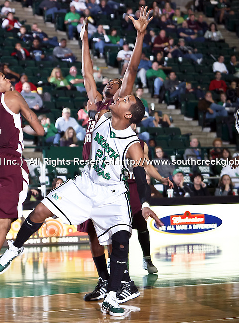 North Texas Mean Green forward Kedrick Hogans (24) blocks out Texas State Bobcats forward Cameron Johnson (23) in the game between the Texas State Bobcats and the University of North Texas Mean Green at the North Texas Coliseum,the Super Pit, in Denton, Texas. UNT defeated Texas State 85 to 62