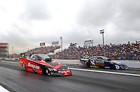 Apr 27, 2014; Baytown, TX, USA; NHRA funny car driver Cruz Pedregon (near lane) races alongside Jack Beckman during the Spring Nationals at Royal Purple Raceway. Mandatory Credit: Mark J. Rebilas-