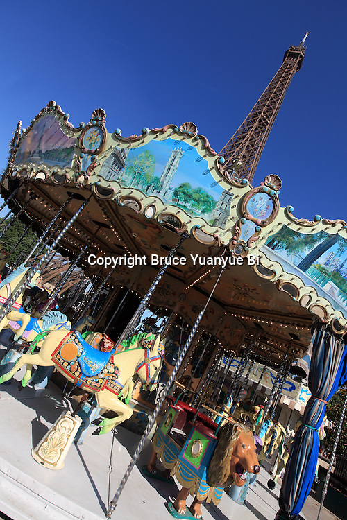 A carrousel with Eiffel tower in the background. City of Paris. Paris. France