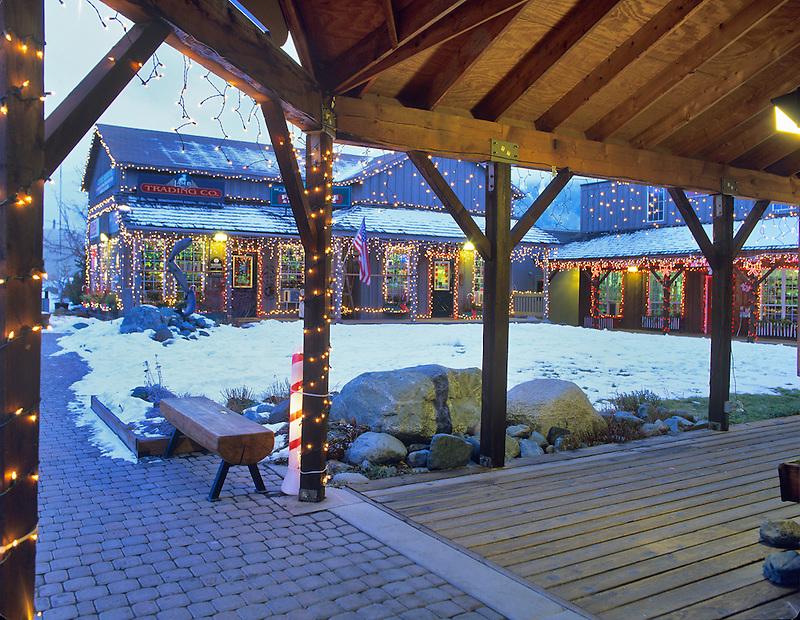 Shopping area with snow and Christmas lights. Joseph, Oregon