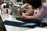 MAY 15, 2014 - KOJIMA, KURASHIKI, JAPAN: workers sew hand made ordered jeans at the Betty Smith's Sewing factory. (Photograph / Ko Sasaki)