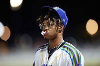 Kannapolis Cannon Ballers pitcher Garvin Alston (15) blows a bubble with his gum during the game against the Lynchburg Hillcats at Atrium Health Ballpark on August 28, 2021 in Kannapolis, North Carolina. (Brian Westerholt/Four Seam Images)