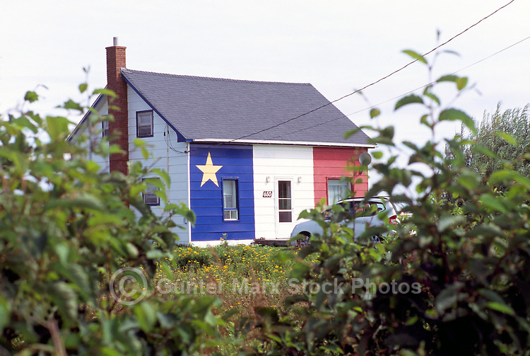 Grande Anse, NB, New Brunswick, Canada - House painted in Acadian Blue, White, and Red Colours of Acadia Flag