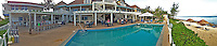 12 July 2013: Poolside panorama view of the Cobalt Coast Resort, in West Bay, Grand Cayman Island. Located in the British West Indies in the  Caribbean, the Cayman Islands are renowned for excellent scuba diving, snorkeling, beaches and banking.  Mandatory Credit: Ed Wolfstein Photo