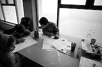 """Nagorny-Karabach, 15.05.2011, Shushi. Kinder malen und zeichnen an einem nebligen Tag im Narecatsi Cultural Center. ..""""The Twentieth Spring"""" - ein Portrait der s¸dkaukasischen Stadt Schuschi, 20 Jahre nach der Eroberung der Stadt durch armenische K?mpfer 1992 im B¸gerkrieg um die Unabh?ngigkeit Nagorny-Karabachs (1991-1994). Kids draw and paint on a foggy day in the Narecatsi Cultural center. ..""""The Twentieth Spring"""" - A portrait of Shushi, a south caucasian town 20 years after its """"Liberation"""" by armenian fighters during the civil war for independence of Nagorny-Karabakh (1991-1994). .Des enfants font des dessin et de la peinture, un jour de brouillard, dans le centre de Narecatsi culturel.""""Le Vingtieme Anniversaire"""" - Un portrait de Chouchi, une ville du Caucase du Sud 20 ans après sa «libération» par les combattants arméniens pendant la guerre civile pour l'indépendance du Haut-Karabakh (1991-1994)..© Timo Vogt/Est&Ost, NO MODEL RELEASE !!"""