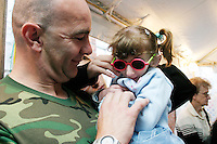 A father dances with his daughter at the Share and Care Network's annual retreat held in Montauk, NY on May 14, 2004.
