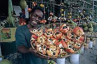 Native Jamaican selling Ackee (National Fruit) at Street Market, Hope Bay, Jamaica, Caribbean