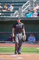 Umpire Steve Craze handles the calls behind the plate during the game between the Idaho Falls Chukars and the Orem Owlz at Melaleuca Field on July 14, 2019 in Idaho Falls, Idaho. The Owlz defeated the Chukars 6-2. (Stephen Smith/Four Seam Images)