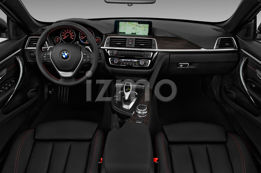 Stock photo of straight dashboard view of a 2020 BMW 4 Series 430i 2 Door Convertible