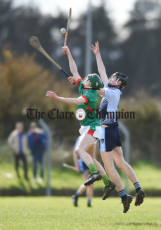 Dylan Doyle of St Fergal's College in action against Fionn Slattery of Scariff Community College during their All-Ireland Colleges final at Toomevara. Photograph by John Kelly.