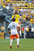 24 JULY 2010:  Corey Ashe of the Houston Dynamo (26) and Emmanuel Ekpo of the Columbus Crew (17)  during MLS soccer game between Houston Dynamo vs Columbus Crew at Crew Stadium in Columbus, Ohio on July 3, 2010. Columbus defeated the Dynamo 3-0.