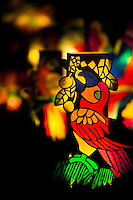 Colorful paper lanterns, depicting birds from tropical rainforests of Amazonia, are seen shining on the street during the annual Festival of Candles and Lanterns in Quimbaya, Colombia, 8 December 2013. A vibrant event, celebrated since 1982 and attracting tens of thousands of visitors every year, is held in honor of the Virgin Mary, on the day of the Catholic Feast of the Immaculate Conception. Each street and neighborhood in the town compete in the contest to create the most spectacular lighting arrangement of their place, employing creatively elaborated lantern designs, which range from religious themes, to symbols of the coffee region or the environmental and wild nature motives. All the streets in Quimbaya center close for one night and some 40,000 lanterns are being lightened up at the festive night.