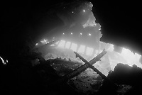 black and white, inside the shipwreck S.S. Dunraven, sunk in 1876 when it hit a reef south of Beacon Rock, Gulf of Suez, Egypt, Red Sea