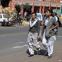 Jaipur, Rajasthan, India.  Mid-day Street Traffic in Central Jaipur.  School Girls in Uniform Walking Home.