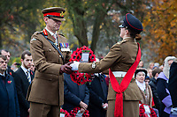 Pictured: An army official is handed over a wreath. Sunday 11 November 2018<br /> Re: Commemoration for the 100 years since the end of the First World War on Remembrance Sunday at York Minster, England, UK