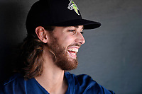 Right fielder Gene Cone (9) of the Columbia Fireflies laughs with teammates in the dugout before a game against the Lexington Legends on Thursday, June 8, 2017, at Spirit Communications Park in Columbia, South Carolina. (Tom Priddy/Four Seam Images)