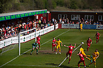 Home supporters in the shed watching the first-half action as Ilkeston Town (in red) host Walsall Wood in a Midland Football League premier division match at the New Manor Ground, Ilkeston. The home team were formed in 2017 taking the place of Ilkeston FC which had been wound up earlier that year. Watched by a crowd of 1587, their highest of the season, the match was top versus second, however, the visitors won 4-0 and replaced their hosts at the top of the division on goal difference with two matches to play
