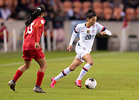 Christen Press #20 of the United States dribbles