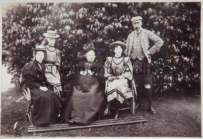 A family photograph of the Victorian generation of Munros sitting in the garden