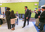 Surrounded by his family, Nevada Gov. Brian Sandoval votes in Reno, Nev., on Tuesday, Nov. 4, 2014. Sandoval is expected to cruise to re-election over a little-known Democrat. (AP Photo/Cathleen Allison)
