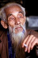 Portrait of a Vietnamese man smoking