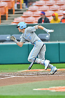 North Carolina Tar Heels left fielder Dylan Enwiller (6) swings at a pitch during a game against the Clemson Tigers at Doug Kingsmore Stadium on March 9, 2019 in Clemson, South Carolina. The Tigers defeated the Tar Heels 3-2 in game one of a double header. (Tony Farlow/Four Seam Images)