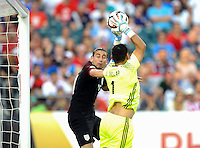 Philadelphia, PA - June 11, 2016: USA midfielder Alejandro Bedoya (11) and Paraguay GK Justo Villar (6) during a Copa America Centenario Group A match between United States (USA) and Paraguay (PAR) at Lincoln Financial Field.